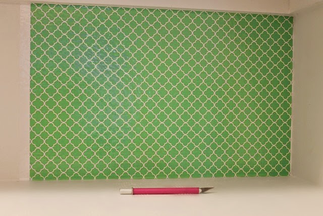 pantry using patterned vinyl as wallpaper