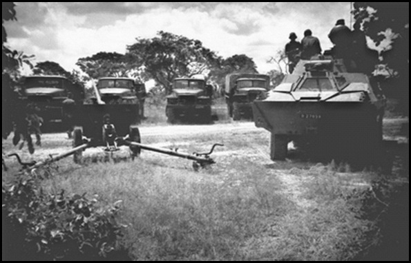 SADF operations in Namibia and Angola OPERATION ASKARI CAPTURED RUSSIAN 76MM Z183 ARTILLERY CANON AND URAL TRUCKS IN FRONT A SADF RATEL ARMOURED CAR