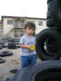 Eidan was more interested in playing in the sand than the tires