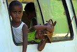 Local Children Play In A Broken Down Minivan - Port Denarau, Fiji