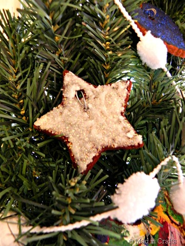 glittered cinnamon ornament on wreath