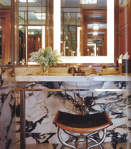 This masculine bathroom was inspired by great Old World hotels, such as Claridge's in London and the Ritz in Paris.