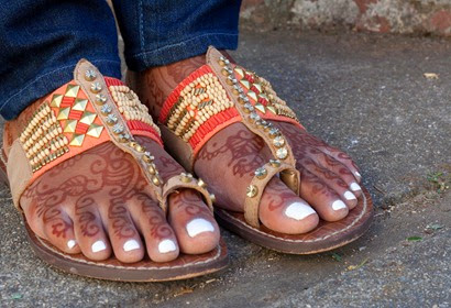 The bride's feet decorated with henna