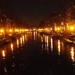 canals of Amsterdam by night in Amsterdam, Noord Holland, Netherlands