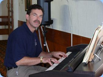 Peter Littlejohn enjoying the Clavinova. Photo courtesy of Dennis Lyons.