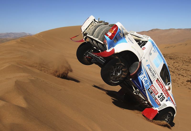 COPIAPO, CHILE - JANUARY 07:  Lucio Alvarez of Argentina jumps his Toyota over a sand dune during stage seven of the 2012 Dakar Rally from Copiapo to Copiapo on January 7, 2012 in Copiapo, Chile.  (Photo by Bryn Lennon/Getty Images,)