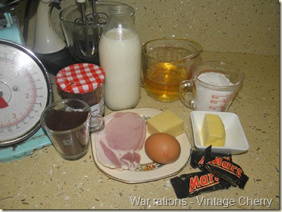 A week of rations, WWII, coffee, jam, milk, oil, sugar, butter, chocolate, egg, cheese and bacon.