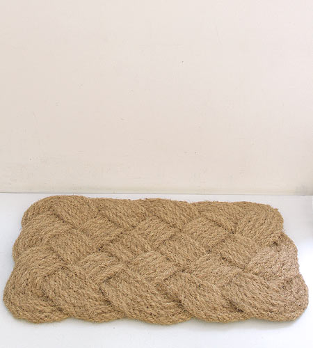 The weaving on this door mat looks almost quilt-like. (brookfarmgeneralstore.com)