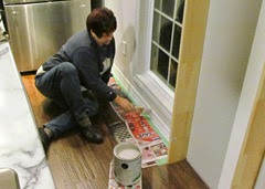 1411177 Nov 18 Barb Painting Kitchen Baseboard