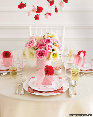 The contrast between pale pink and bright red in this floral tablescape will wow your guests. Calm, delicate pinks can actually serve to highlight more passionate bold accents.