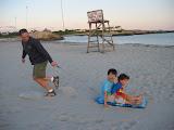 Paul pulling Kai and Eidan across the sand