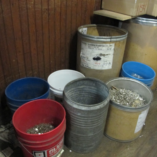 Barrels and buckets organize screws and bolts.
