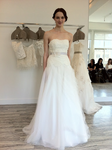This dress has an embroidered Guipure lace bodice and tulle skirt. You can wear it with or without the belt.