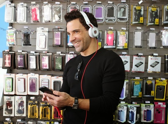 George Kotsiopoulos listens to music on his iphone with Beats by Dre Headphones at RadioShack