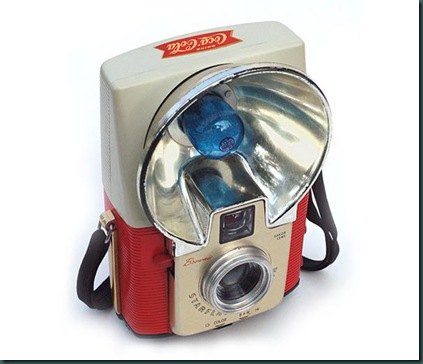 "Like so many Kodak cameras, the Brownie Starflash sold well in its time, making it rather common for collectors today. Not so common is this two-tone version, available only as a premium and not for retail sale. It sports appropriate Coca-Cola colors as well as a ""fishtail logo"" decal on top. The original black Starflash was introduced in March of 1957. Other colors followed a year later. Production of the Coca-Cola model began in October 1959, and this example was made in November of 1959."