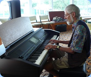 Errol Storey famiarizing with the Clavinova. Errol normally plays theatre organ and so the relaxed atmosphere of Coffee Day was a great opportunity to spend some quality time on our lovely Clavinova CVP-509. Photo courtesy of Dennis Lyons.