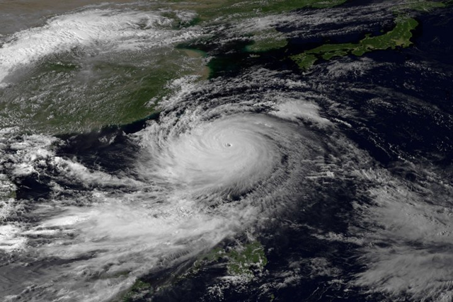 Satellite view of Typhoon Usagi, the most powerful typhoon of the year, which swept through the Luzon Strait separating the Philippines and Taiwan on Saturday, 21 September 2013, battering island communities and dumping rain as it approached landfall Sunday in Hong Kong. The storm system dumped up to 520 millimeters (20 inches) of rain along the eastern and southern coasts of Taiwan in a 20-hour period. Photo: JMA via NOAA