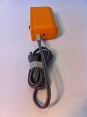 orange Braun HLD 4 hair dryer with cord