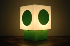 white lamp with green base and green dot