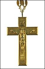 Жовтий нагрудний хрест. Традиційно називають золотим наперсним хрестом або протоієрейським хрестом