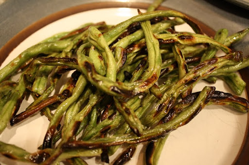 I love grilling my string beans with a touch of olive oil, salt and pepper.