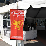 The banner says it all as alumnae arrive at the registration tent.