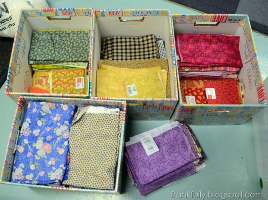 fabric sorted by color into bankers boxes