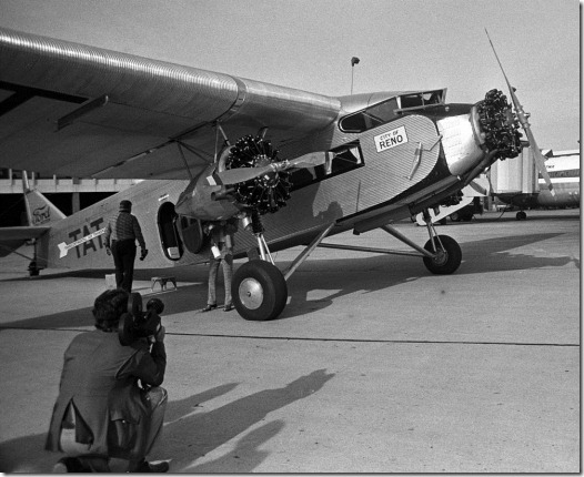 A Ford Tri-Motor in the livery of Transcontinental Air Transport, the forerunner of Trans World Airlines, as it would have appeared at the inauguration of TWA's transcontinental passenger service in 1929. This aircraft toured the U.S. for the 45th anniversary of TWA's transcontinental service in 1974. The plane is now housed at the McMinnville, Ore., airport and flies at airshows. This photo was made at Weir Cook (now Indianapolis International) Airport. <br />