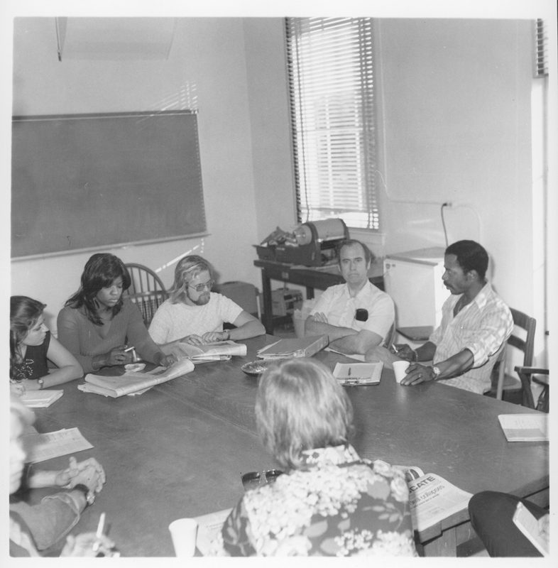 Student/journalism meeting regarding the Los Angeles Collegiate including Muriel Bunton (second from left), Gay Students Union President Larry Kephart (third from left), and editorial manager of the Collegiate Max Thompson (far right). 1974.