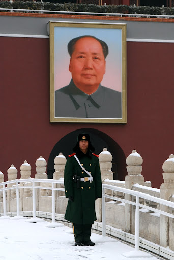 One of the guards under the ever present (and very near by) Chairman Mao outside The Forbidden Palace.
