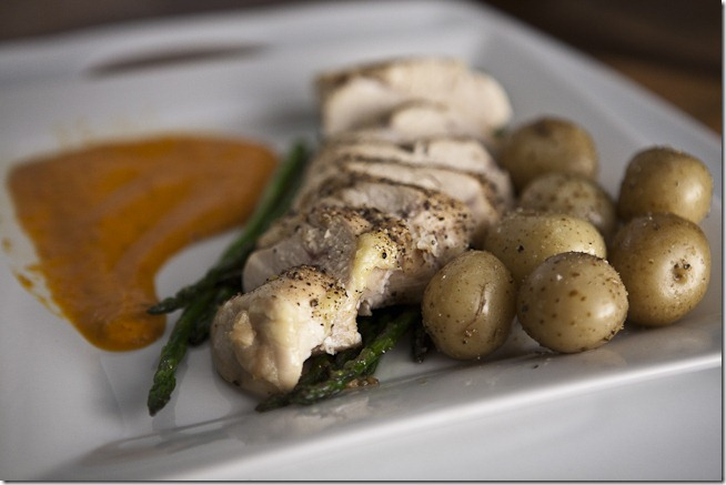 Oven Roasted Seasoned Chicken Breast over Garlic Sauteed Asparagus with Colombian Baby Potatoes and Red Pepper Sauce-1