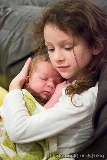 Abby holding sleeping Ethan blog-1