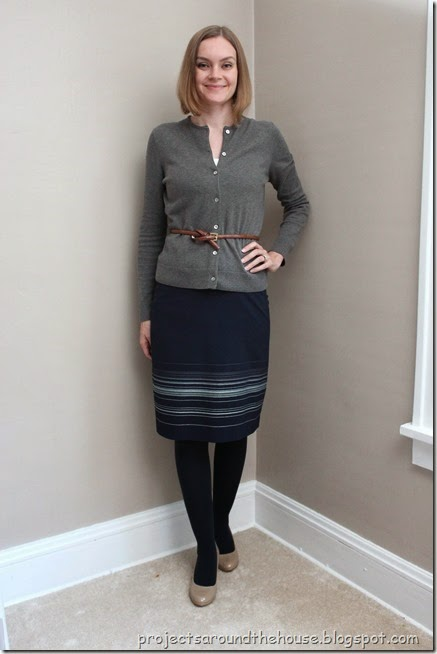 Grey cardigan, navy skirt, navy tights