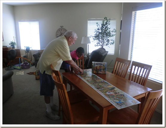 8-22-11 Grandad and Bailey doing puzzle on table