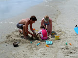 Digging in the sand with mommy and Chad. (July)
