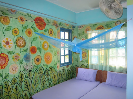 Our colorful room at Tahan Guest House.