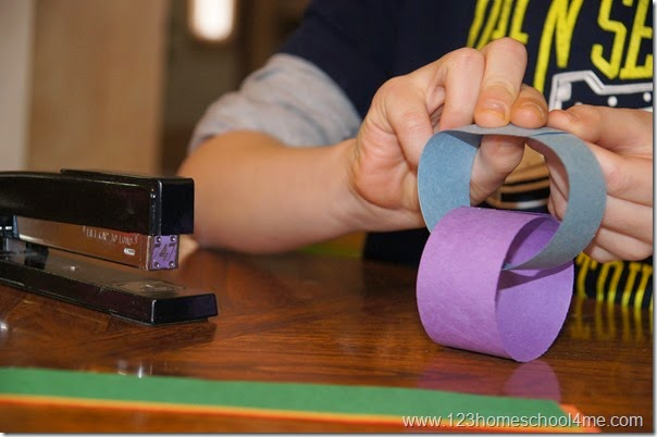 Make links with strips of construction paper and a stapler