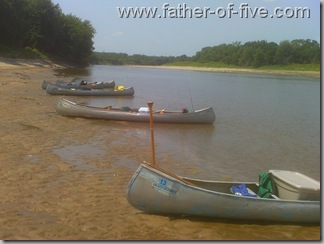 Canoes parked on the sand bar