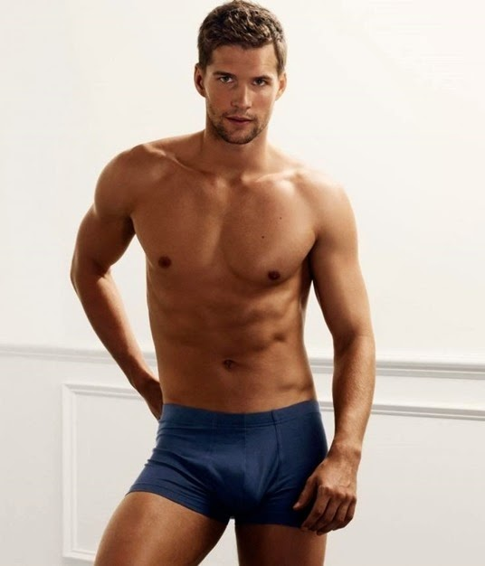 sexy guy in blue trunks
