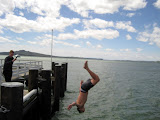 North Island - some dude back flipping in the Auckland bay... it was freezing!
