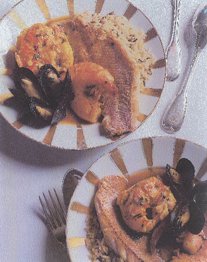 Caribbean-influenced bouillabaisse served over wild rice in Old Paris porcelain bowls. (Martha Stewart Living)