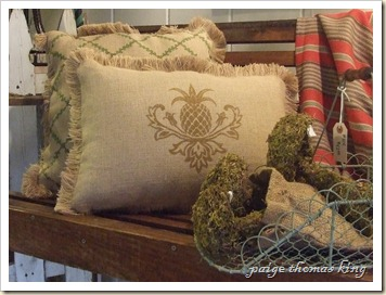 porch swing, burlap eco pillows, and mossy mushrooms