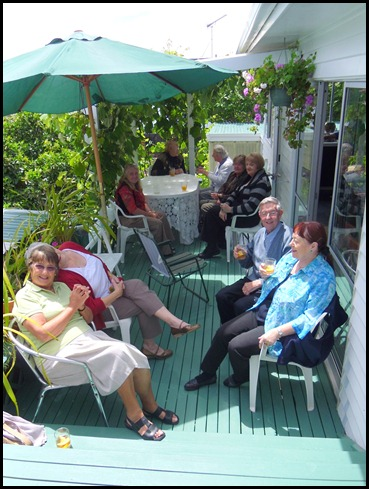 Some of our members enjoying a glass of punch and soaking up the sunshine on Delyse's deck.