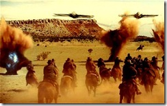 """In this film publicity image released by Universal Pictures, a battle scene is shown in """"Cowboys & Aliens"""". (AP Photo/Universal Studios-Dreamworks II Distribution)"""