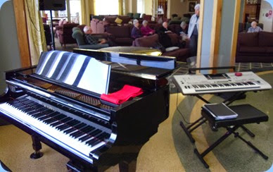 The Knightsbridge Kawai grand piano and some of our Club members and residents relaxing to the music.