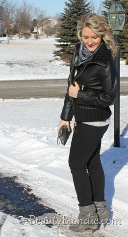 Black Skinny Pants, Black Leather Coat with Short Grey Boots, a Grey Scarf and Big Curly Hair