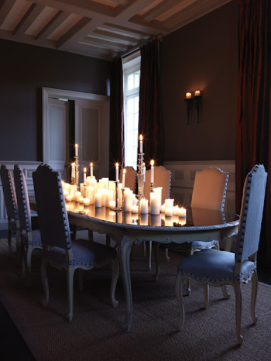An artfully jumbled collection of candles-pillars, tapers, and votives make a romantic and dramatic center-piece.