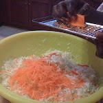 Grate carrot. (Haitian Food)