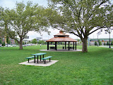 Several picnic tables surrond the gazebo.