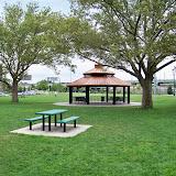 Several picnic tables surrond the gazebo.